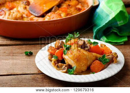 Chicken stewed with pumpkin and mushrooms. Selective focus