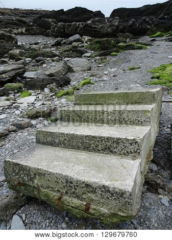 Beach Steps And Cliffs Seascape Photographed At Looe In Cornwall