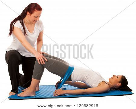 Physiotherapy - Therapist Doing   Excercises With Band For Improving Back Strenght And Stability Wit