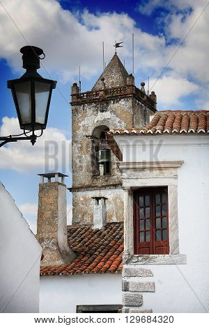 Front view of typical Portuguese house with church
