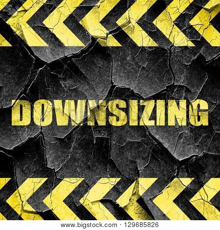 downsizing, black and yellow rough hazard stripes