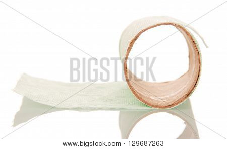 Leftover tissue paper roll on white isolate background