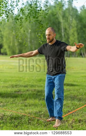 Man practising slack line in the park