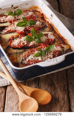 Italian Eggplant Melanzane Alla Parmigiana Close Up In Baking Dish. Vertical