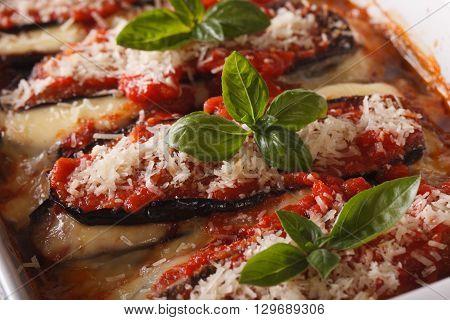 Italian Cuisine: Melanzane Alla Parmigiano Macro In The Baking Dish. Horizontal