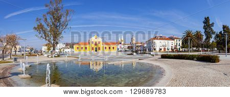 Nisa, Portugal. February 26, 2015: View of the Republica Square, also known as Rossio, in the town of Nisa with the Municipal Library. Nisa, Portugal