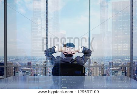 Back view of thoughtful businessman sitting on chair in office admiring New York city view. Double exposure poster