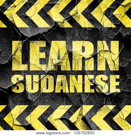 learn sudanese, black and yellow rough hazard stripes