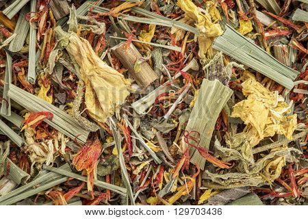 Closeup background of an arthritis  and back pain  herbal tea including lemon balm, safron, primrose and lemon grass