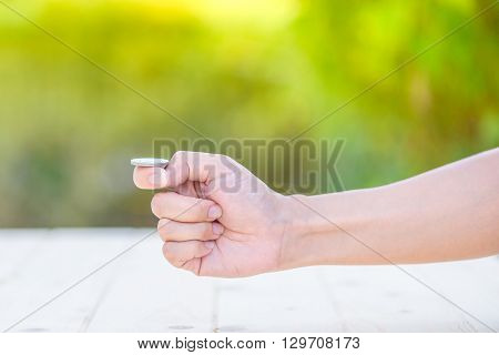 Hand Of Woman Prepare For Flip A Coin