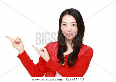 portrait of Japanese woman presenting and showing something on white background