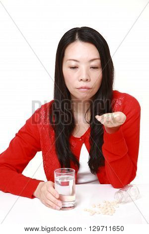 portrait of Japanese woman suffers from melancholy on white background