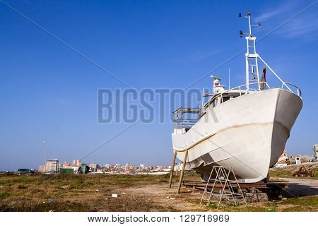 Fishing ship, a trawler being built or under maintenance in Povoa de Varzim, Portugal.