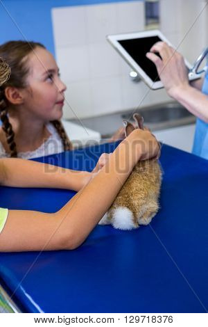 Close up of little boy petting a rabbit on the operating table