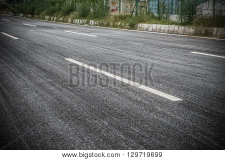 an empty blacktop in a day time