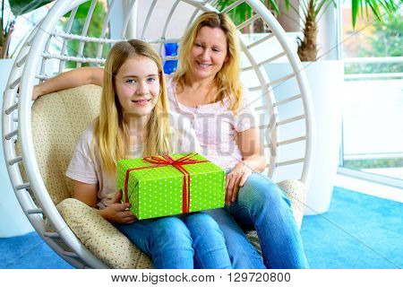 Mother And Daughterl With Green Gift Box