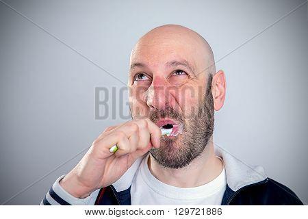 Funny Bald Headed Man Brushing Teeth