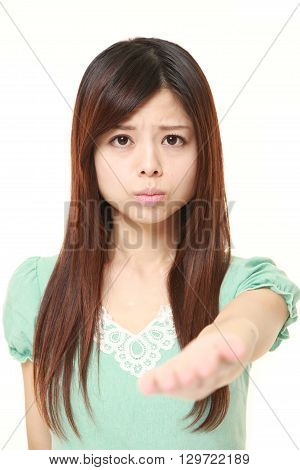 portrait of angry young Japanese woman requests something