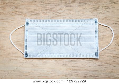 Close up Dust mask on wooden background