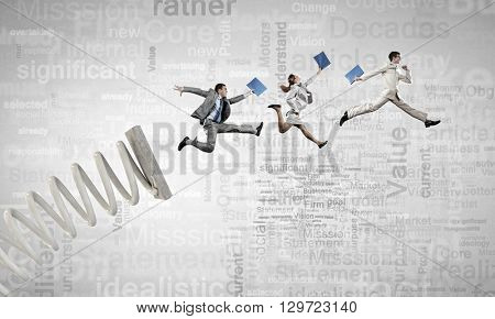 Business people jumping high