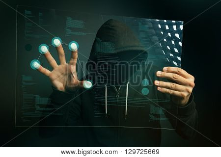 Fingerprint identification app on futuristic tablet computer device hooded computer hacker hacking biometric security internet system.