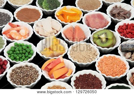 Body building high protein health food of meat and fish with supplement powders, grains, seeds, pulses, fruit and vegetables. Selective focus.