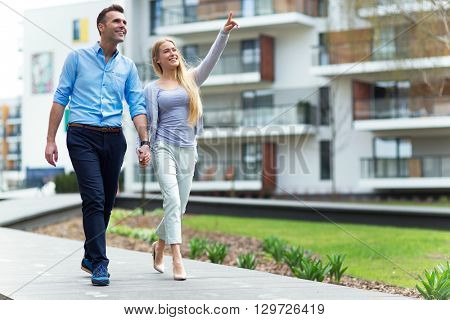 Young couple in modern residential area