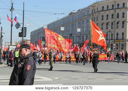 St. Petersburg, Russia - 1 May, The red banners of Lenin Komsomol, 1 May, 2016. Day festive demonstration on the Nevsky Prospect in St. Petersburg, the first of May.
