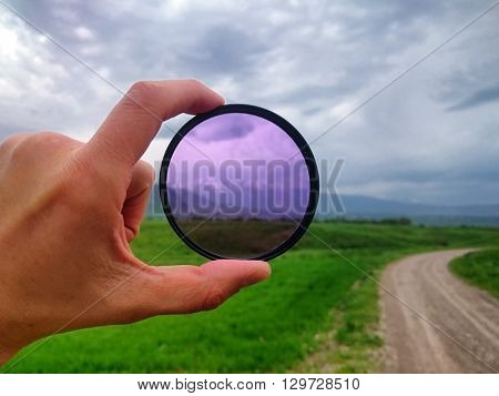 Landscape through a filter in hand