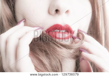 Close-up Of Woman's Face With Vibrant Red Lipstick