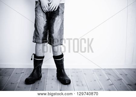 Legs Of Teenager With Wet Pants And Boots
