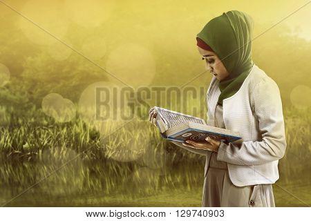 Asian Muslim Woman Reading Koran