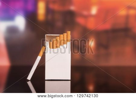 Opened pack of cigarettes close-up on a background of the restaurant
