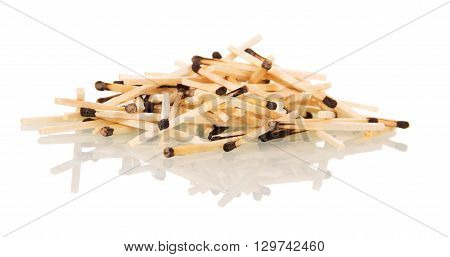 A handful of charred matchsticks isolated on white background