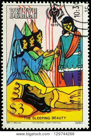 MOSCOW RUSSIA - MAY 14 2016: A stamp printed in Belize shows sleeping princess and prince - a scene from the fairy tale