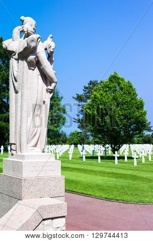 Colleville Sur Mer France - May 23 2012: Normandy a statue in the memorial of the American Cemetery of the second World War.