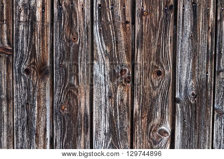 detail of a dark wooden pine wood barn door