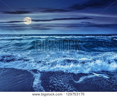 Sea ​​waves Crashing On Sandy Beach At Night
