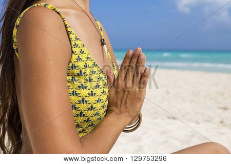 Woman meditating at the beach in a yoga retreat. Playa del Carmen, Mexico.