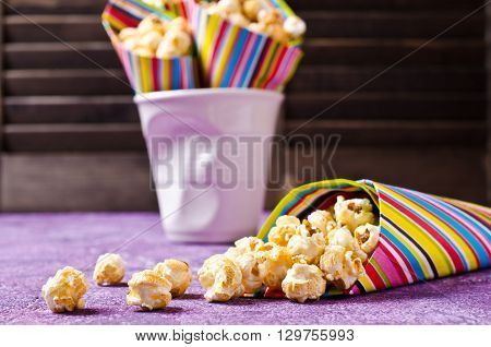 Homemade crunchy caramel popcorn ready for use. Selective focus.