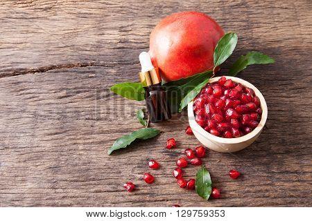 Serum Bottle With Fresh Pomegranate