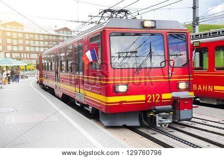 Kleine Scheidegg Switzerland - July 09 2012: Train from Kleine Scheidegg arrives from Jungfraujoch station.