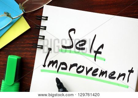 Self improvement sign written in a notepad.