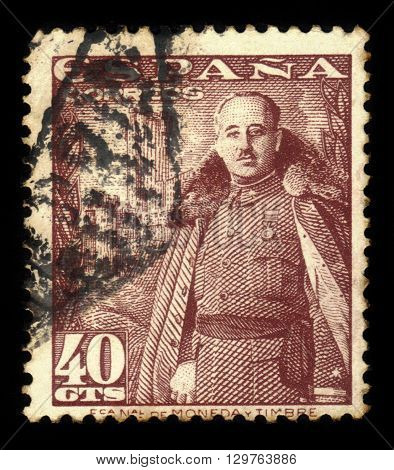 SPAIN - CIRCA 1948: a stamp printed in the Spain shows General Franco, Caudillo of Spain in front of the Castle of La Mota, red brown, circa 1948