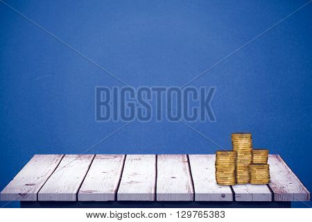 Gold coins against blue background
