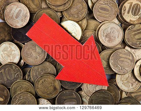 Red Arrow Down on the Russian Coins Background