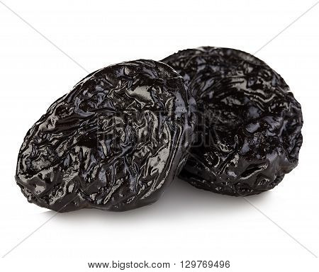 Raw Organic Prunes, Dried Plums, Smoked Prunes Close-up On A White Background.
