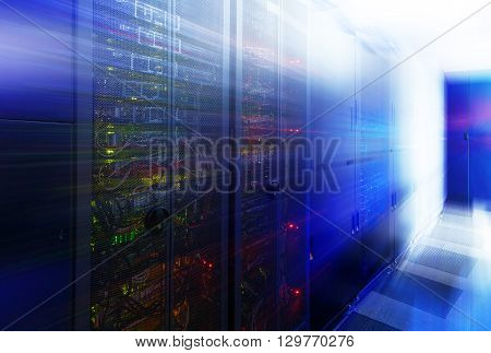 abstract room with rows of server hardware in data center