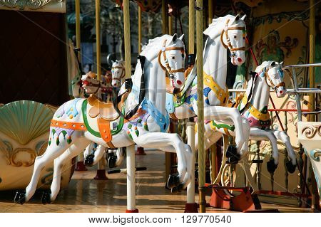 detail of white horses and carriage in a carousel roundabout or merry-go-round retro style