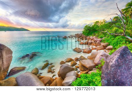Beautiful sunset over the famous beach Anse Lazio, Praslin island, Seychelles.